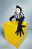 Circus Fashion Mime Posing Near A Yellow Square Stock Photography