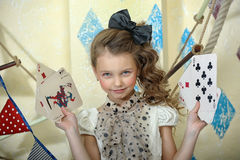 Circus girl. Litle young girl circus with playing cards Stock Images