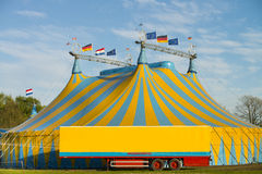Circus international. Blue and yellow striped circus tents under a blue sky Royalty Free Stock Photography