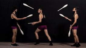 Circus jugglers during their batons performance Royalty Free Stock Image