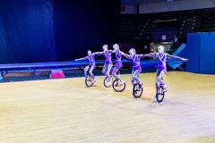 Circus kids performing on unicycle Royalty Free Stock Photos