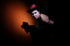 Circus lady in shadows. Pale looking woman dressed in black in shadows Royalty Free Stock Photos