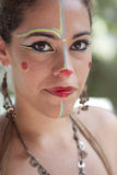 Colorful traditional makeup. Woman with her face painted ready to take part on a traditional street parade Stock Image