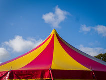 Circus Marquee Tent. The top of a circus marquee tent, with red and yellow stripes against a blue sky stock images