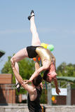 Circus Performer Lifts Female Over His Head Royalty Free Stock Photography