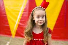 Circus Princess. Funny portrait of a six-year girl in the crown near the circus tent Stock Image