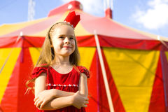 Circus Princess. Funny portrait of a six-year girl in the crown near the circus tent Royalty Free Stock Image