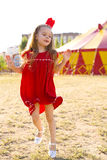Circus Princess. Funny portrait of a six-year girl in the crown near the circus tent Stock Photo
