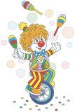 Funny clown juggler and equilibrist Royalty Free Stock Images