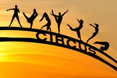 Circus silhouettes and sign in sunset sky Stock Photos