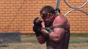 Circus Strongman. Circus athlete muscle tension tearing the chain. Slow Motion at a rate of 240 fps