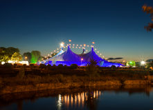 Circus style tent and Galway Cathedral on the bank of the river royalty free stock images
