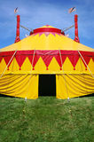 Circus tent. Close up of a circus tent that is on bright green grass and a blue sky Royalty Free Stock Photo