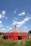 Circus tent. That is on bright green grass and a blue sky Royalty Free Stock Photos