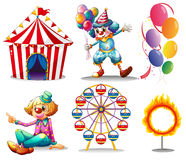 A circus tent, clowns, ferris wheel, balloons and a ring of fire. Illustration of a circus tent, clowns, ferris wheel, balloons and a ring of fire on a white Stock Photo