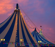 Circus tent in a dramatic sunset sky colorful. Orange blue with lights Royalty Free Stock Photos