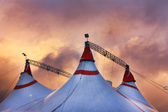 Circus tent in a dramatic sunset sky. Colorful orange blue with lights Royalty Free Stock Photo
