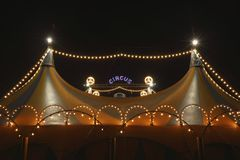 Circus tent at night. A circus tent at night. The circus tent is lit with bright and colored lights Stock Images