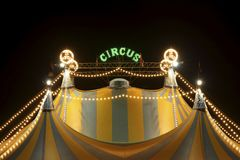 Circus tent at night. A circus tent at night. The circus tent is lit with bright and colored lights Stock Photography