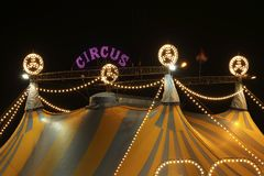 Circus tent at night. A circus tent at night. The circus tent is lit with bright and colored lights Royalty Free Stock Photography