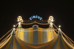 Circus tent at night. A circus tent at night. The circus tent is lit with bright and colored lights royalty free stock image