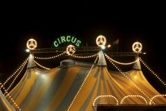 Circus tent at night. A circus tent at night. The circus tent is lit with bright and colored lights Stock Photo