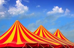 Circus tent red orange and yellow stripped pattern. Blue sky royalty free stock photography