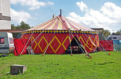 Circus tent. Red and yellow circus tent, with cloudy sky stock photography