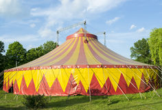 Circus tent. In red and yellow colors installed for representations in a park stock photo