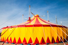 Circus tent. Red and yellow striped circus tent with blue sky Royalty Free Stock Image