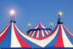 Circus tent under blue sky colorful stripes. Red white Royalty Free Stock Photos