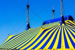Circus tent in yellow blue colors stock photography