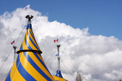 Circus Tents. Tops of circus tents against the clouds Royalty Free Stock Photography