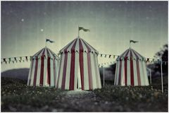 Circus tents on green field. 3d illustration royalty free illustration