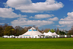 Circus tents in park. Circus big top tents surrounded by caravans in rural park Royalty Free Stock Photos