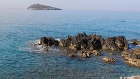 Cirella Island from the cliff. Cirella, Cosenza, Calabria, Italy - August 25, 2017: Cirella island seen from the cliff stock video footage
