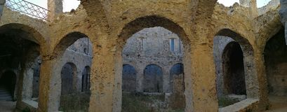 Cirella - Overview of the cloister of the Convent of the Mines. Cirella, Cosenza, Calabria, Italy - August 25, 2017: Panoramic photo of the cloister of the Royalty Free Stock Photos