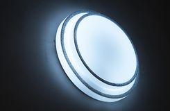 Cirkel witte gloed op donkere achtergrond stock foto