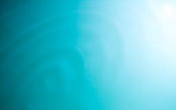 Cirkelbakgrund för blått vatten, krusningsvatten Royaltyfria Foton