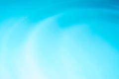 Cirkelbakgrund för blått vatten, krusningsvatten Arkivbild