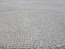 Cirkelmodell som göras av kullerstentrottoar Royaltyfri Fotografi