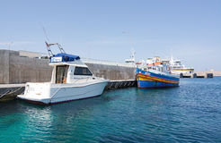 Cirkewwa ferry terminal. CIRKEWWA, MALTA - SEPTEMBER 16, 2015: Ferry boat moored in the terminal to Gozo and Comino islands on a sunny day in September 16, 2015 Stock Images
