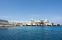 Cirkewwa ferry terminal. CIRKEWWA, MALTA - SEPTEMBER 16, 2015: Ferry boat moored in the terminal to Gozo and Comino islands on a sunny day in September 16, 2015 Stock Image