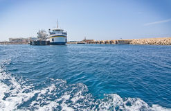 Cirkewwa ferry terminal. CIRKEWWA, MALTA - SEPTEMBER 16, 2015: Ferry boat moored in the terminal to Gozo and Comino islands on a sunny day in September 16, 2015 Stock Photography