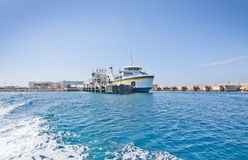 Cirkewwa ferry terminal. CIRKEWWA, MALTA - SEPTEMBER 16, 2015: Ferry boat moored in the terminal to Gozo and Comino islands on a sunny day in September 16, 2015 Royalty Free Stock Photos