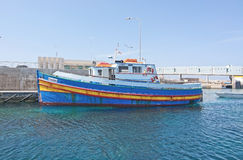 Cirkewwa ferry terminal. CIRKEWWA, MALTA - SEPTEMBER 16, 2015: Ferry boat moored in the terminal to Gozo and Comino islands on a sunny day in September 16, 2015 Royalty Free Stock Images
