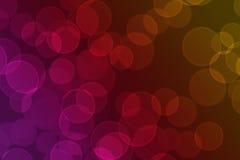 Cirklar av ljus på en rosa, röd och orange bakgrund Royaltyfria Bilder