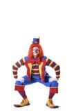 cirkusclown som squatting Fotografering för Bildbyråer