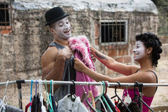 Cirque Clowns Fitting Costumes. Two laughing cirque clowns fitting costumes outdoors Royalty Free Stock Image