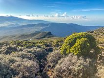 Sunset view on mountains from piton des neiges on la reunion island. Cirque de cilaos at sunset view from piton des neiges royalty free stock photography